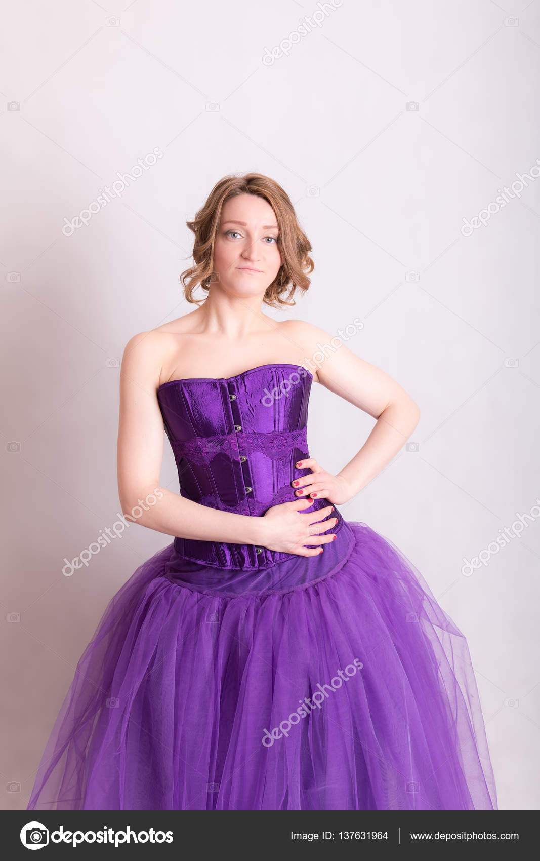 woman in a purple evening gown — Stock Photo © Argument #137631964