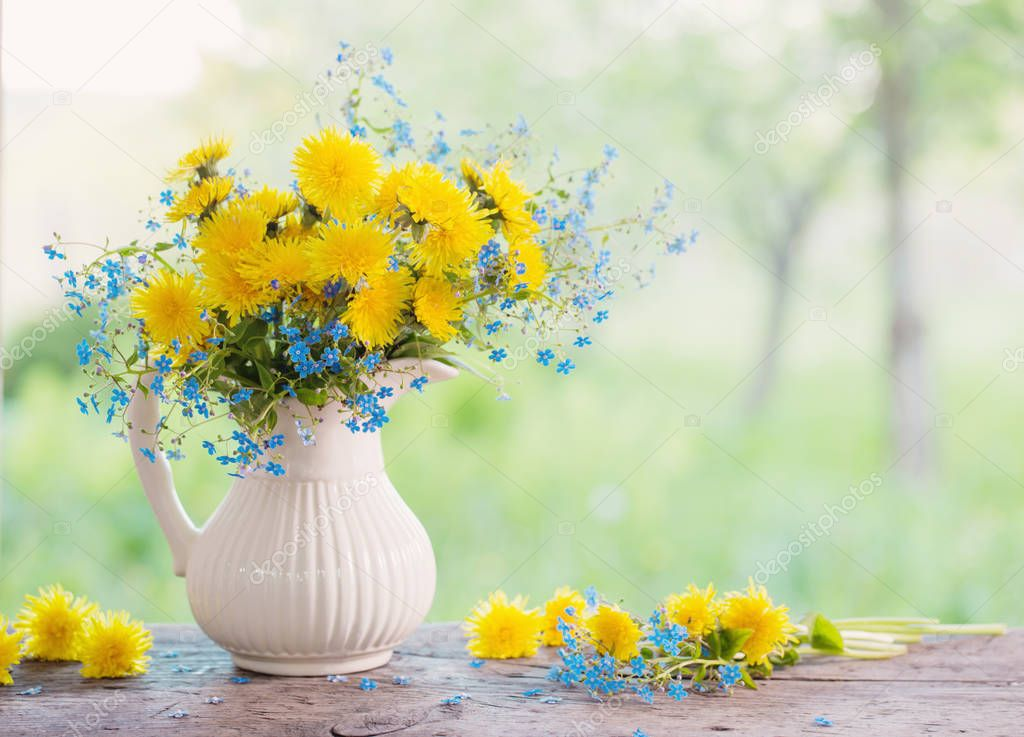 bouquet with forget-me-not and dandelions