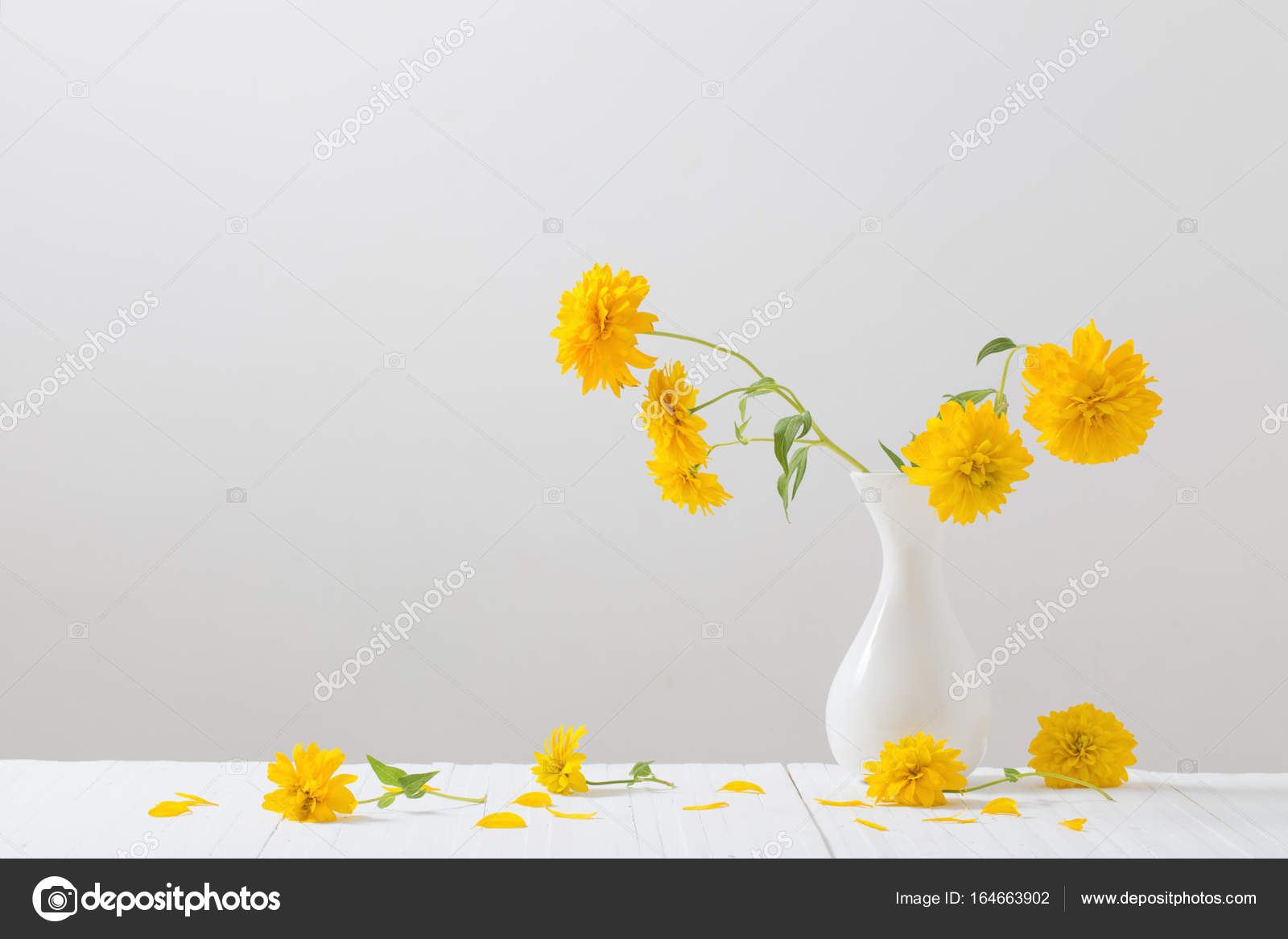 Yellow Flowers In Vase On White Background Stock Photo