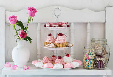 pink cakes on plate on white background