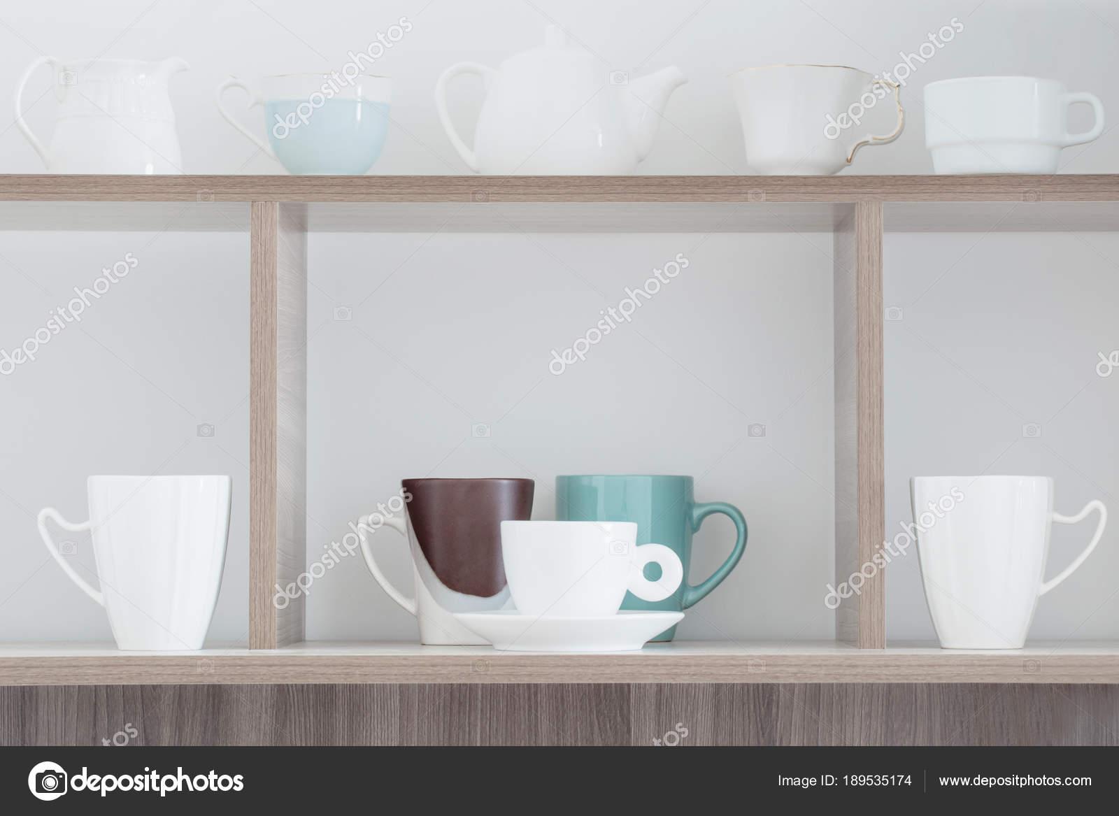 white kitchenware on wooden shelf — Stock Photo © Kruchenkova #189535174