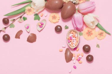 Easter pink background with eggs and flowers