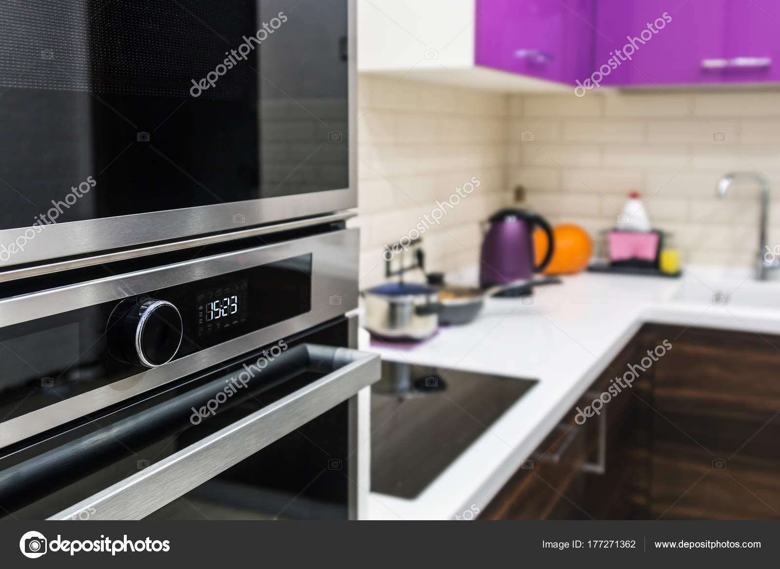 Kitchen Appliances Built Into Kitchen Cabinets Stock Photo