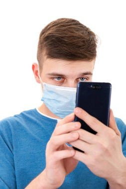 Young Man in Flu Mask take a Photo with a Mobile Phone Isolated on the White Background