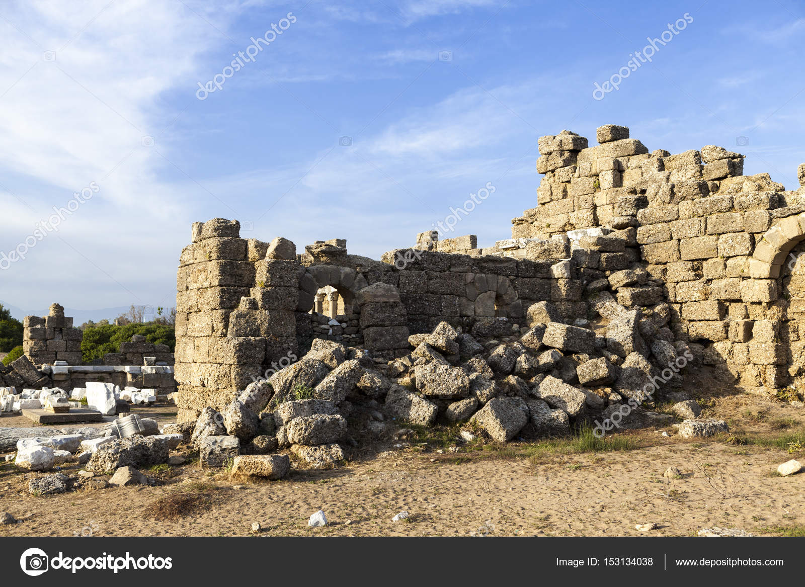 Beautiful background with ancient ruins and Sunny summer day. The old ruined  walls of the ancient city . ⬇ Stock Photo, Image by © mcherevan #153134038