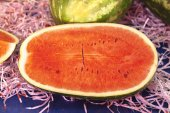 A large slice of ripe juicy watermelon at the village market.