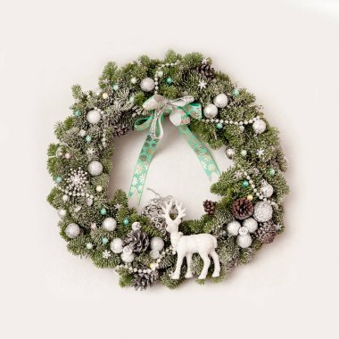 Christmas wreath with cones, Christmas toys, sprinkled with arti