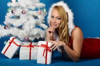 young woman in Santa Claus clothes