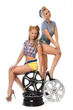 Girls with automobile tyres