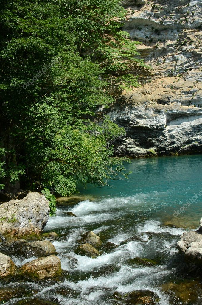 a blue lake in mountains