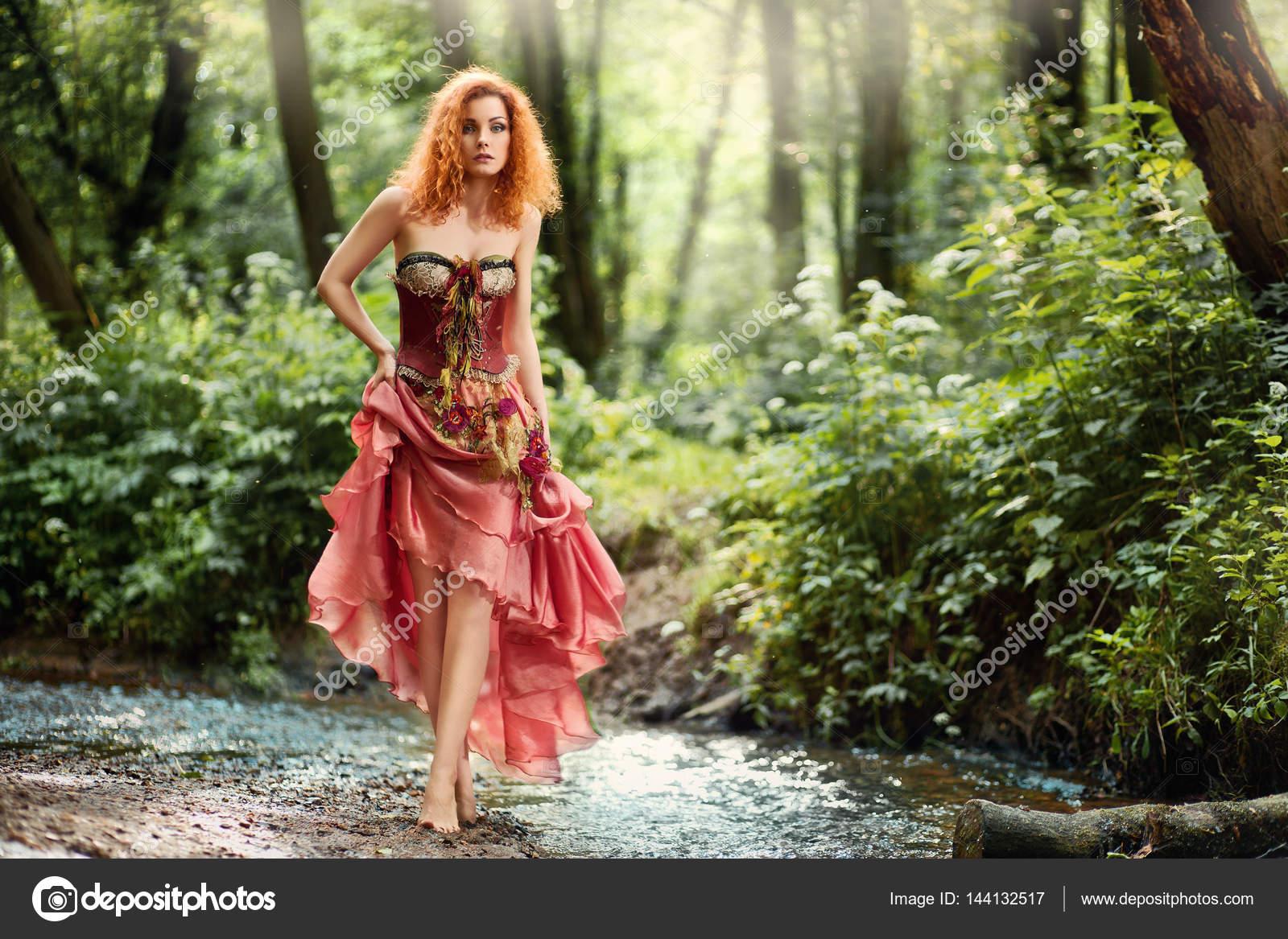 https://st3.depositphotos.com/1001478/14413/i/1600/depositphotos_144132517-stock-photo-beautiful-girl-in-red-dress.jpg
