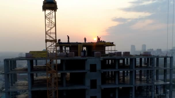 Builders On The Roof Of Skyscraper Are Working Stock Video