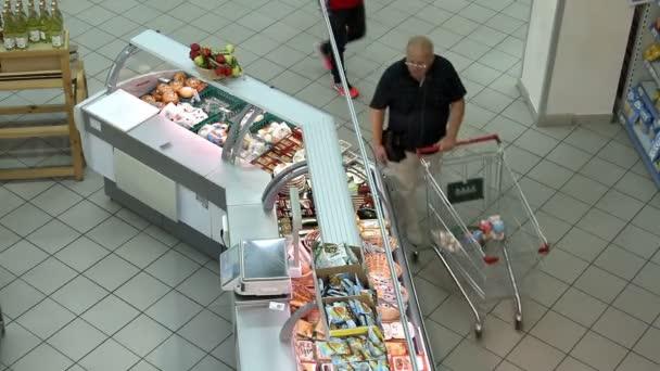 People shopping in hypermarket