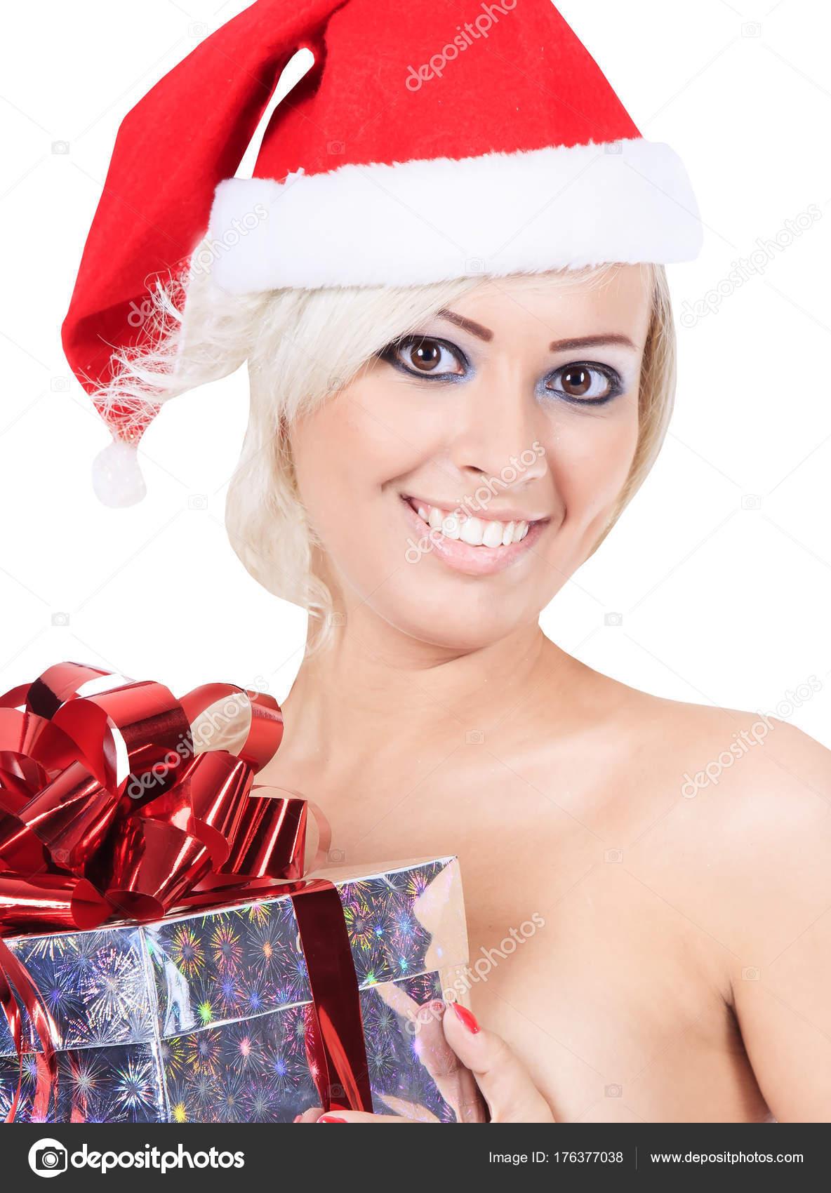 Wunderbar weiblich in Nikolausmütze mit Weihnachtsgeschenk ...