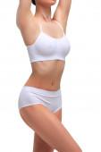 Sexy žena s štíhlým krásným tělem. Liposukci, strava a zdravý životní styl, koncepce úbytku váhy. Izolované na bílém pozadí