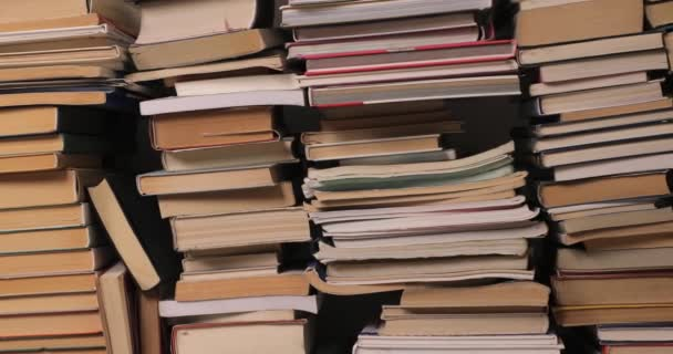 Wall of books piled up