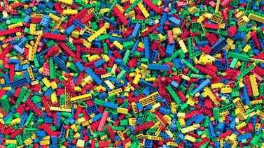 Lot of various colored toy bricks background