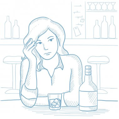 Woman drinking alcoholic drink at the bar.