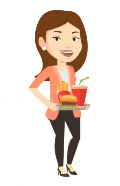 Woman holding tray full of fast food.