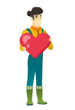 Asian farmer holding a big red heart.