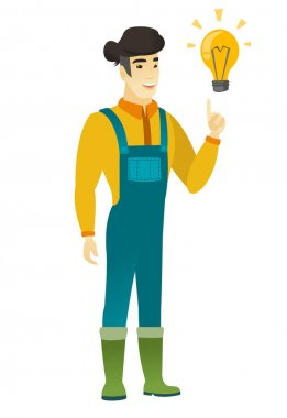 Farmer pointing at bright idea light bulb.
