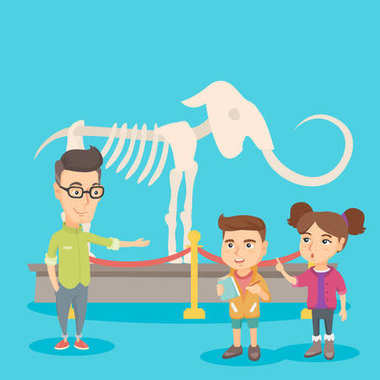 Kids with a teacher studying a skeleton in museum.