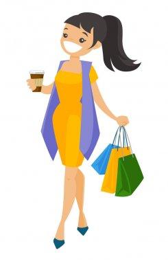 Young caucasian white woman carrying shopping bags