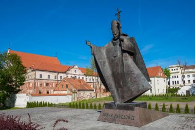 Kaunas, Lithuania - May 12, 2017: The statue of Pope John Paul II in the exact place where he held holy Mass in 1993 in the old town of city. Kaunas, Lithuania.