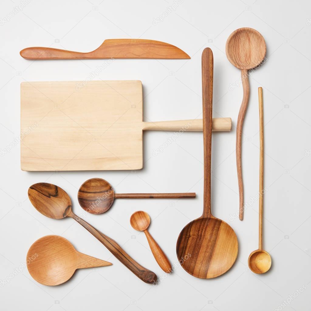 Various kitchen utensil on white wooden background — Stock Photo ...