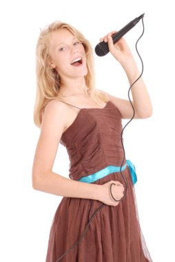 Happy young beautiful girl singing with microphone
