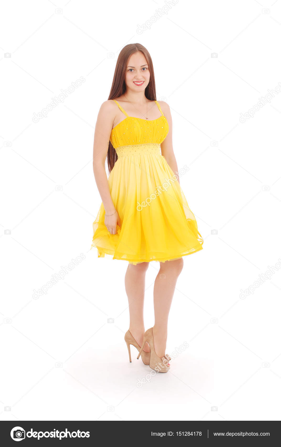 Teenage Girl Is Standing Back Yellow Dress.