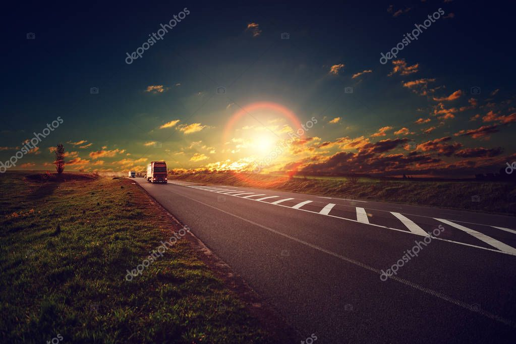 truck on a highway at sunset.