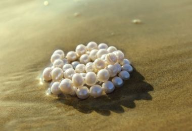 Pearl beads on the sea sand