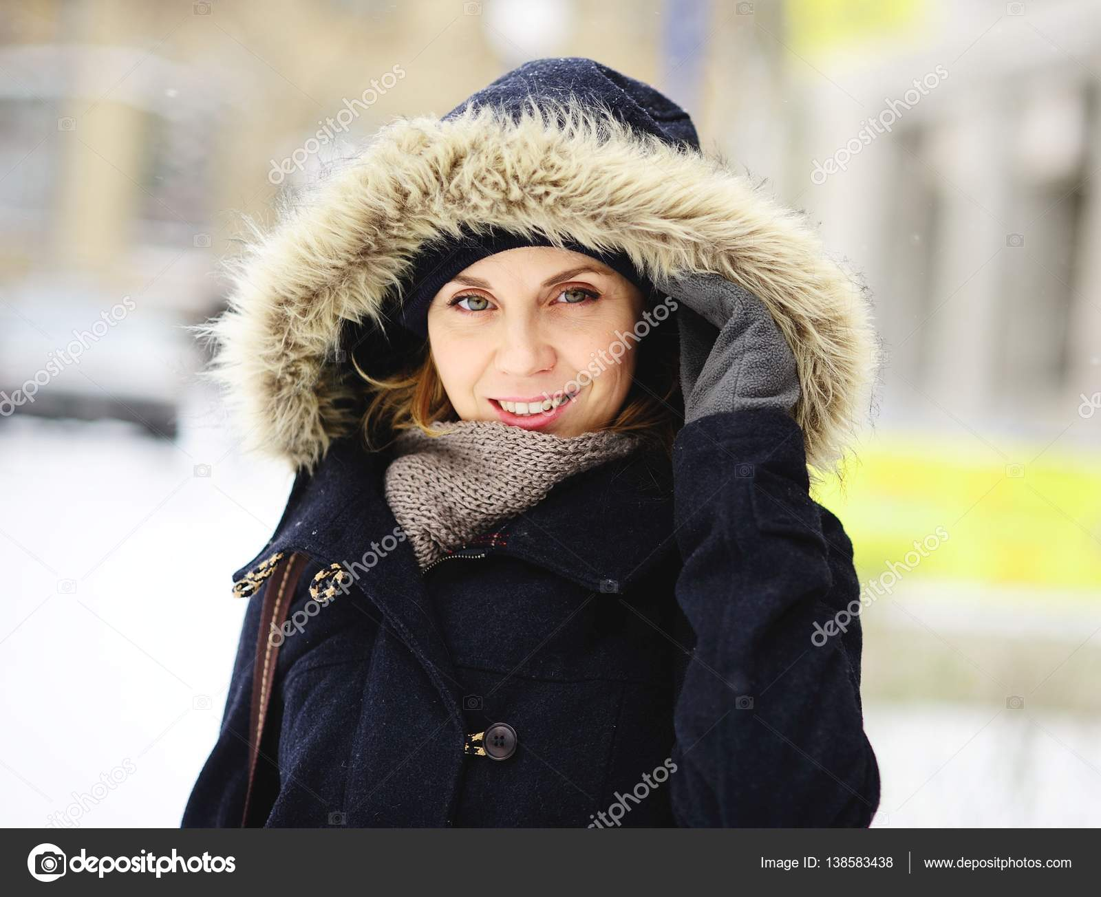 faadf7da70580 Portrait of the beautiful young woman in a winter coat with fur hood. —  Stock