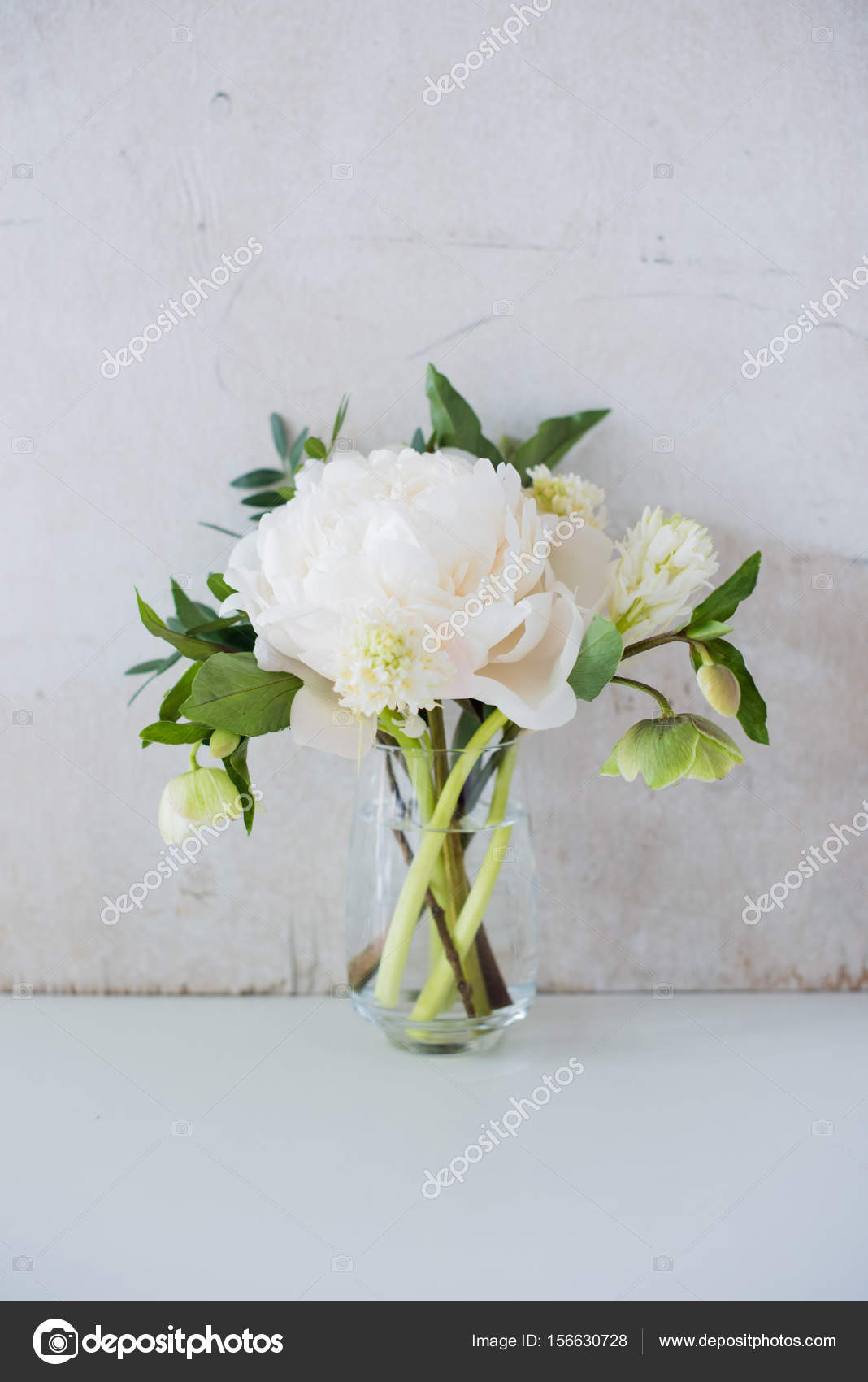 White Peony Flowers On Coffee Table In White Room Interior Brig