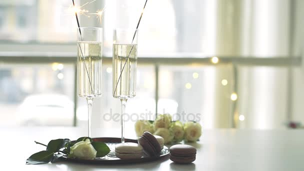 Luxurious champagne wedding party with white roses and macaron ...