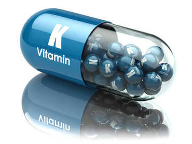 Vitamin K capsule or pill. Dietary supplements.