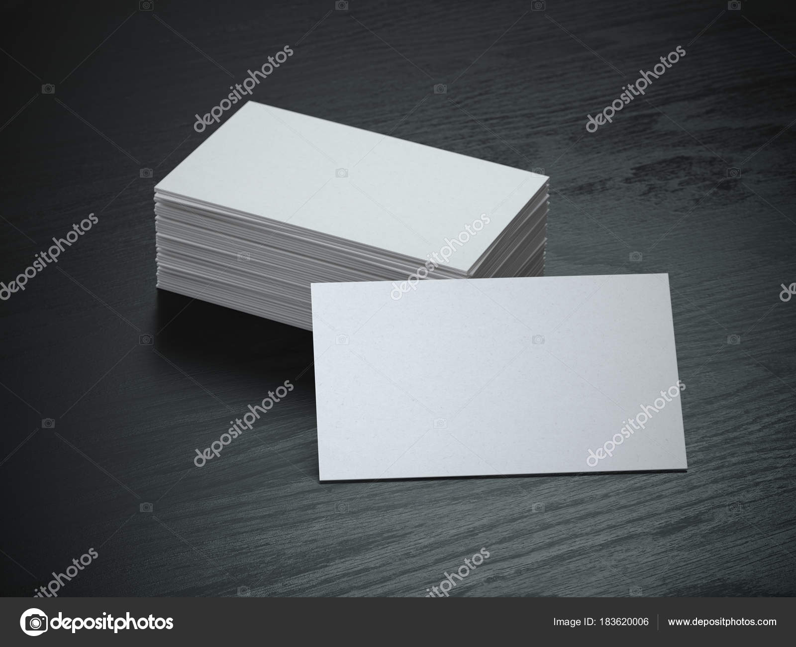 White blank business cards mockup on black wood table background ...