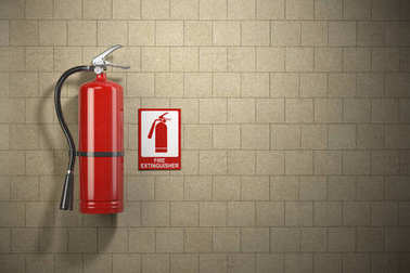Fire extinguisher with emergency fire sign on the wall backgroun