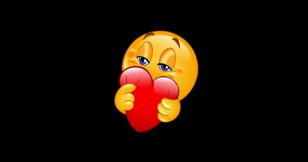 Animace emojiho emotikonu objímajícího červené srdce. Včetně alfa kanálu.