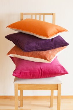 colorful cushions on chair cozy home mood
