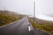 national tourist road 55 Sognefjellsvegen in misty weather, Norw