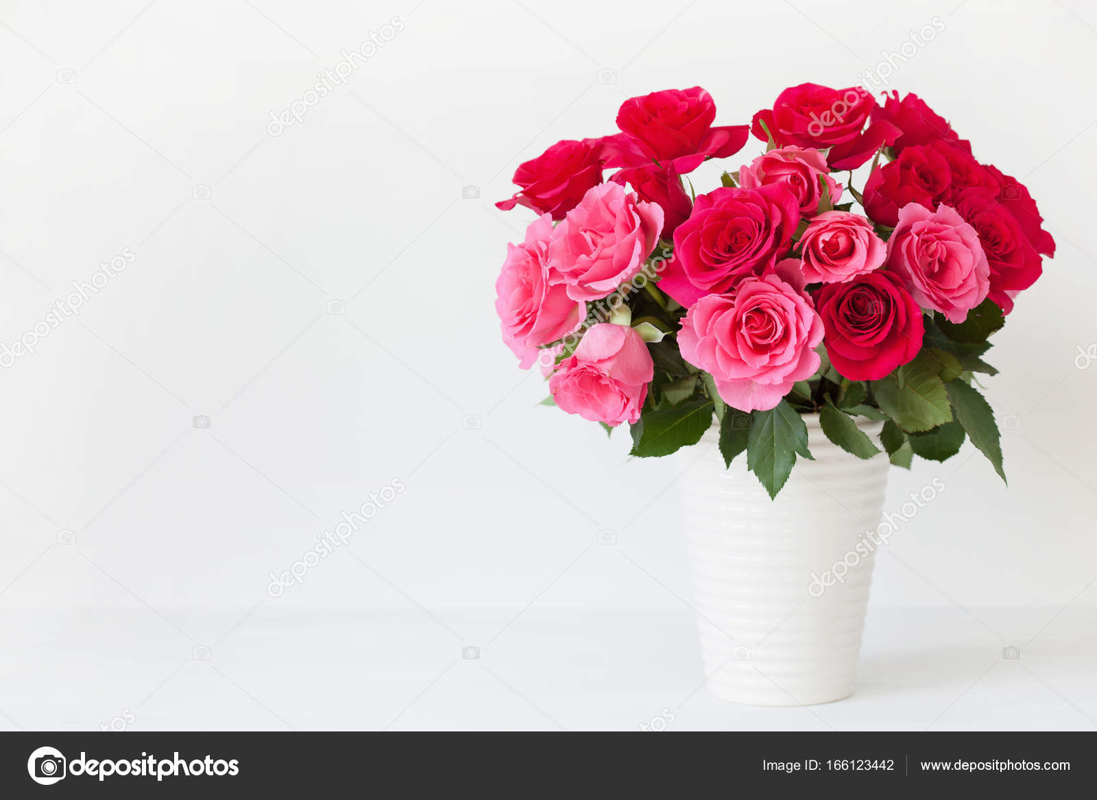 beautiful red rose flowers bouquet in vase over white — Stock Photo ...