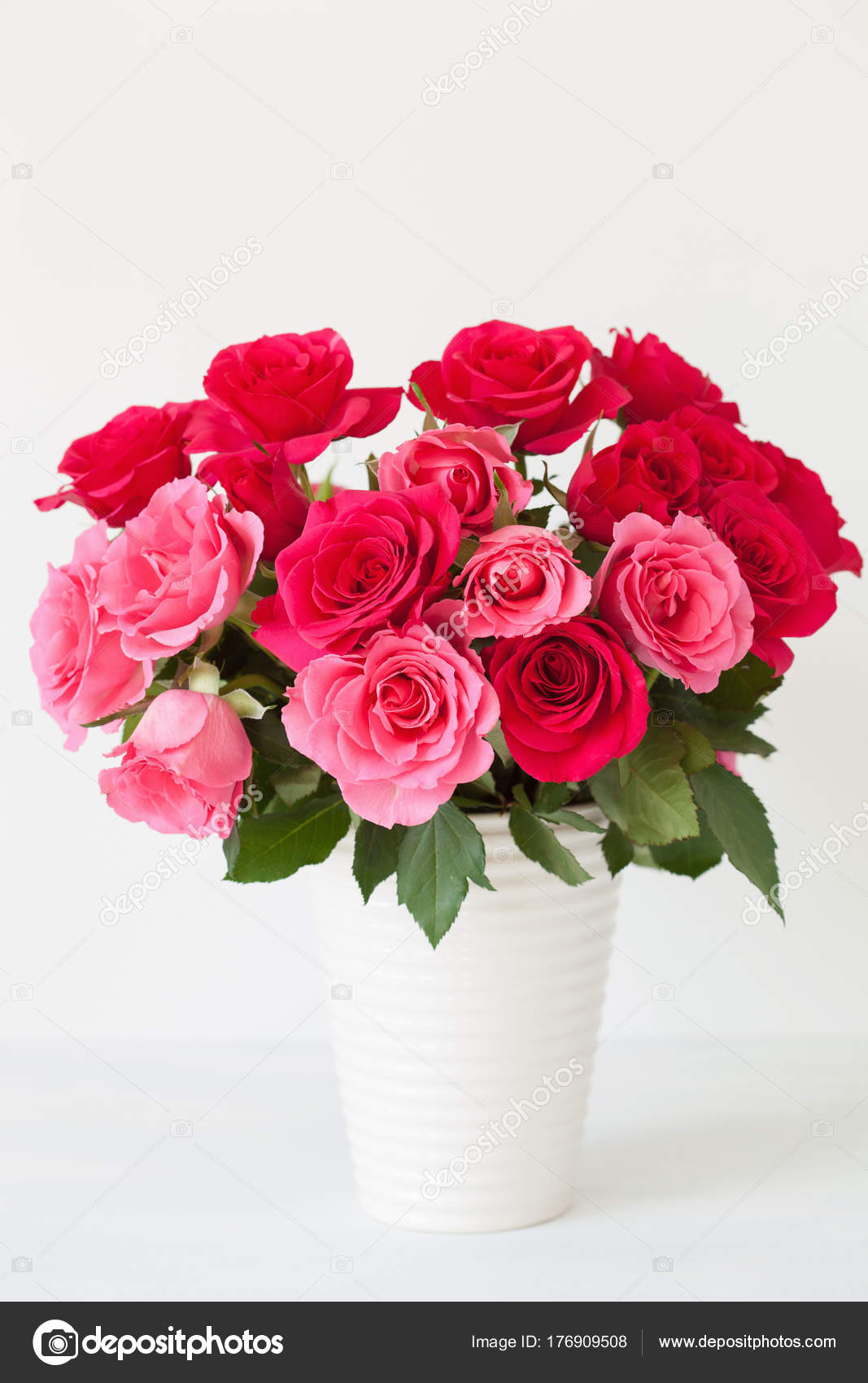 Beautiful red rose flowers bouquet in vase over white stock photo beautiful red rose flowers bouquet in vase over white photo by duskbabe izmirmasajfo