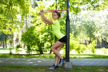 Female exercising with fitness trx straps