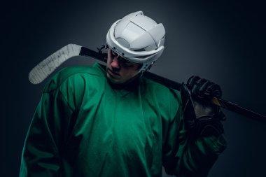 Hockey player holds gaming stick