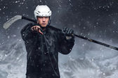 Hockey player in a snow storm.