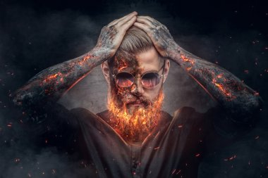 Demonic male with burning beard
