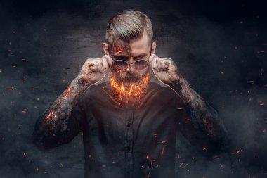Demonic male with burning beard