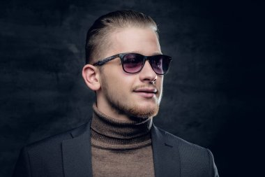 Portrait of stylish man in sunglasses and turtle-neck sweater on dark grey background. stock vector